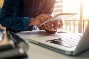man-using-laptop-and-ipad